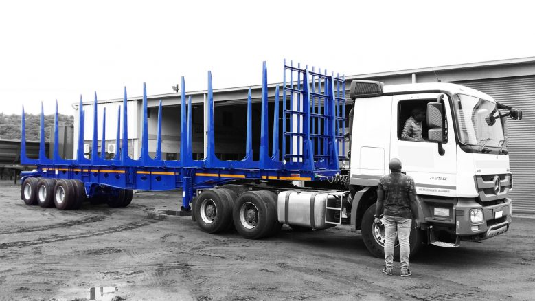 tri Axle timber trailer painted blue